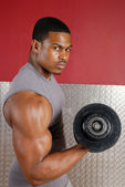 African american lifting weights
